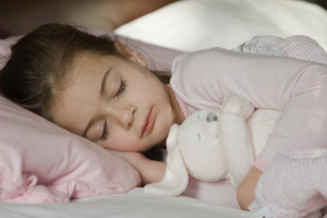 child-sleeping-with-stuffed-animal